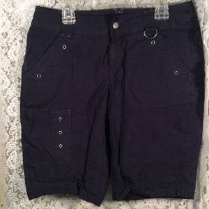 Navy blue cargo shorts with pink accents